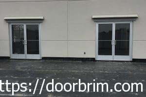 Rain diverter above roof access door.