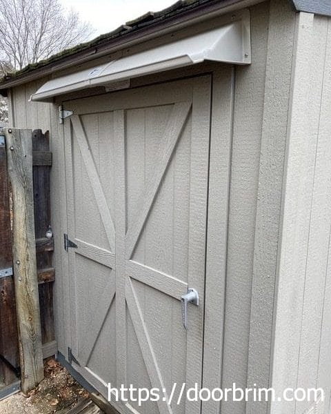 DOORBRIM rain guard for sheds stops door leaks.