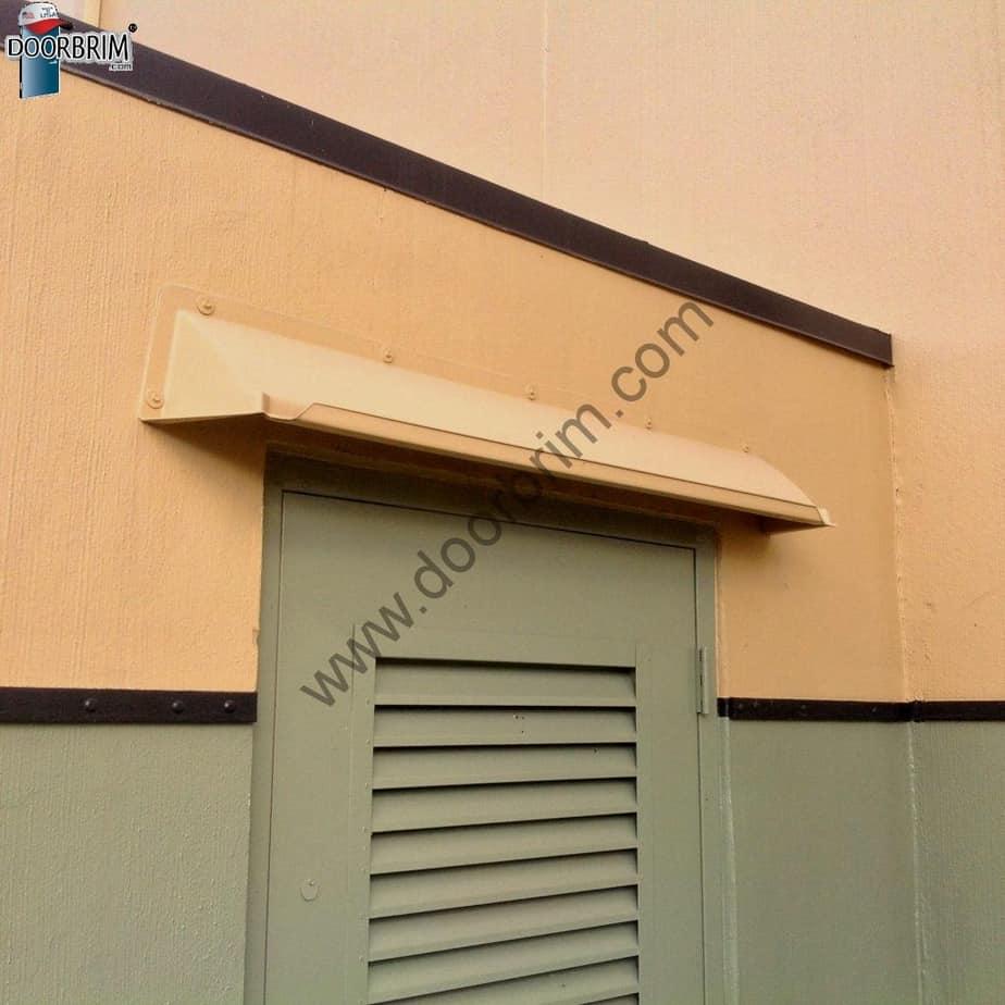 door hood on concrete tilt building