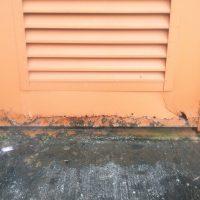 Rain bouncing off sidewalks will also create rust.